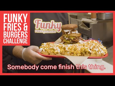 The 6-pound funky fries mac and cheese burger challenge is undefeated