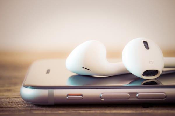 Closeup iphone headphone on cell phone