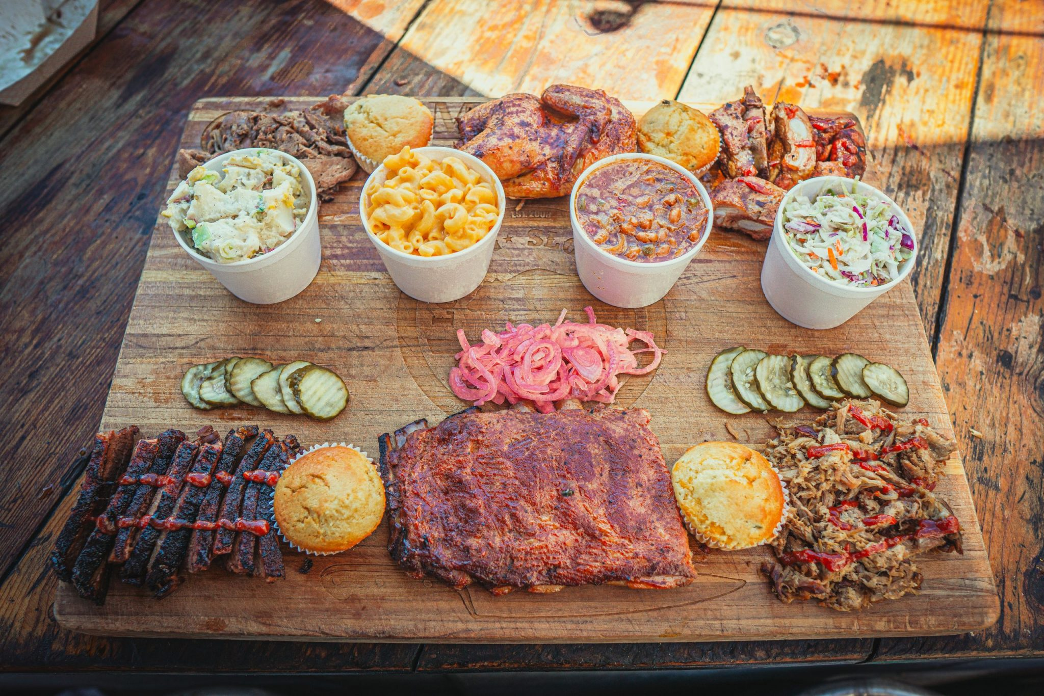 The Tailgaters BBQ Feast at Cali Comfort BBQ has smoked meat and sides