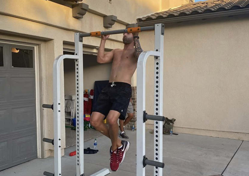 Josh palet does pullups during the murph 2020 on the cali bbq host team