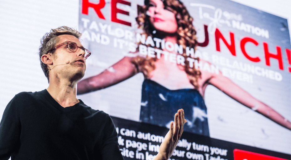 Brendan Kane speaking in front of Taylor Swift picture