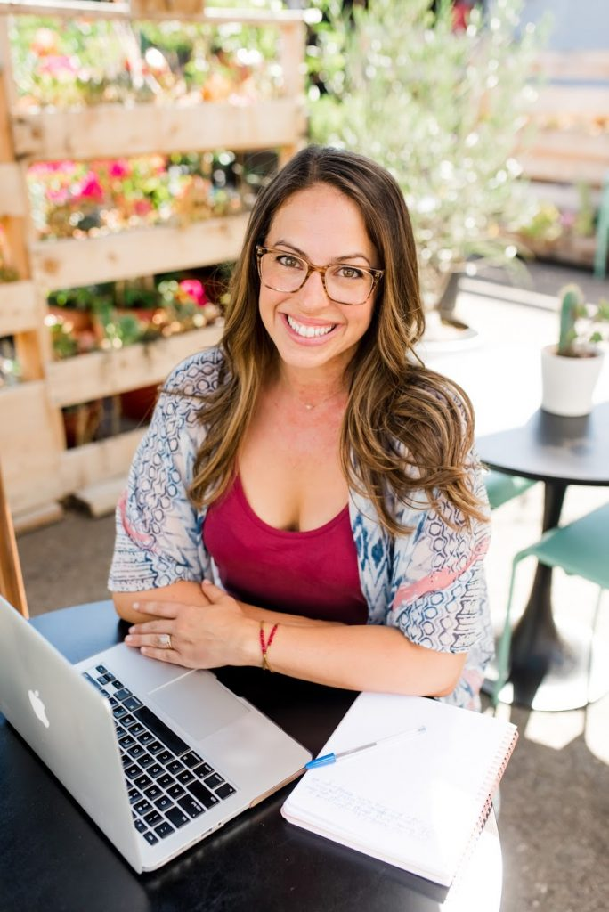 Emily silva author on her laptop