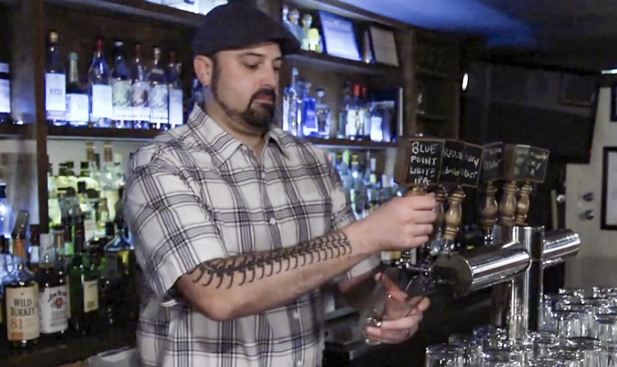 Rev ciancio pours beer at idle hands bar in nyc