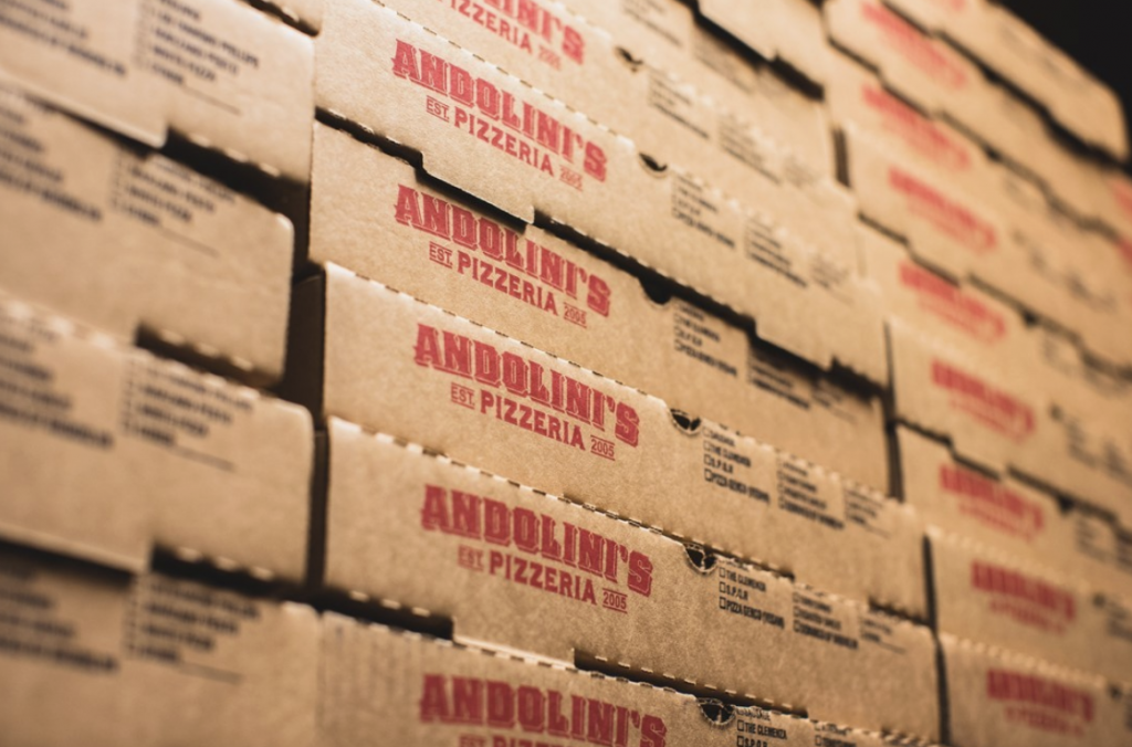 Andolini's pizzeria boxes stacked up