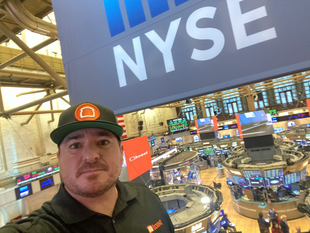 Shawn walchef at the new york stock exchange with toast