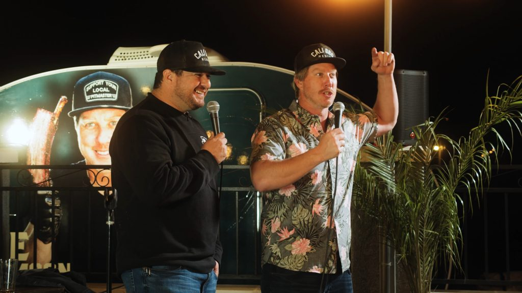 Dave williamson on stage at cali bbq with owner shawn walchef